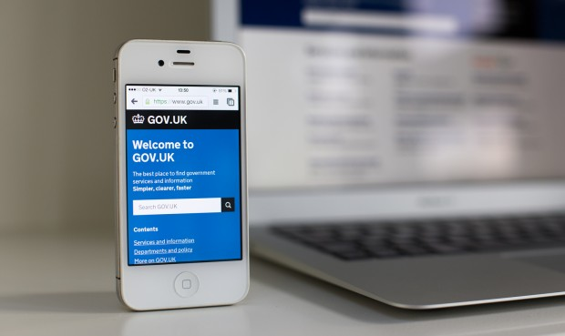 A smart phone displaying the GOV.UK homepage.