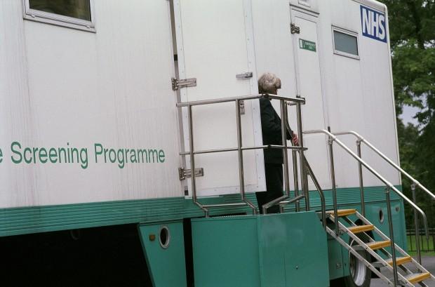 Woman leaving breast screening mobile unit.
