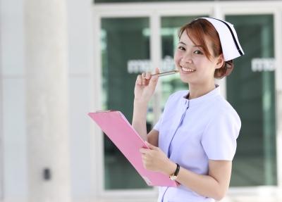 A nurse holding a clipboard and pen.