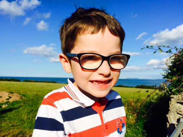 Cameron, aged 5, with his second pair of glasses.