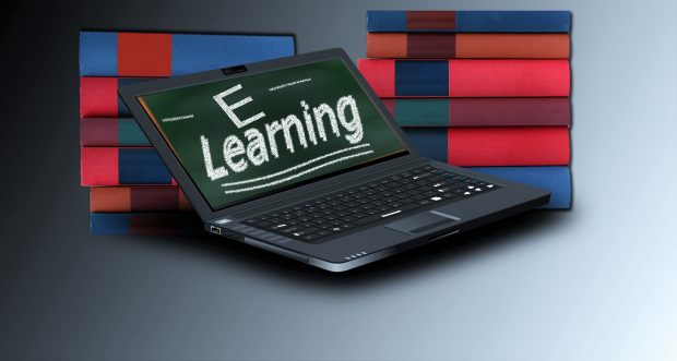 Laptop and books depicting e-learning