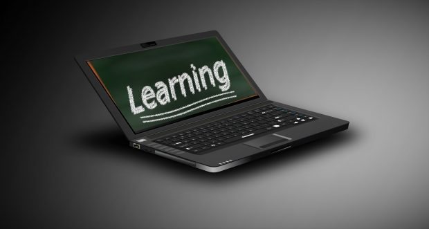 A laptop with the word 'Learning' written on screen.