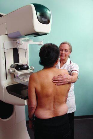 A woman is having a mammogram.