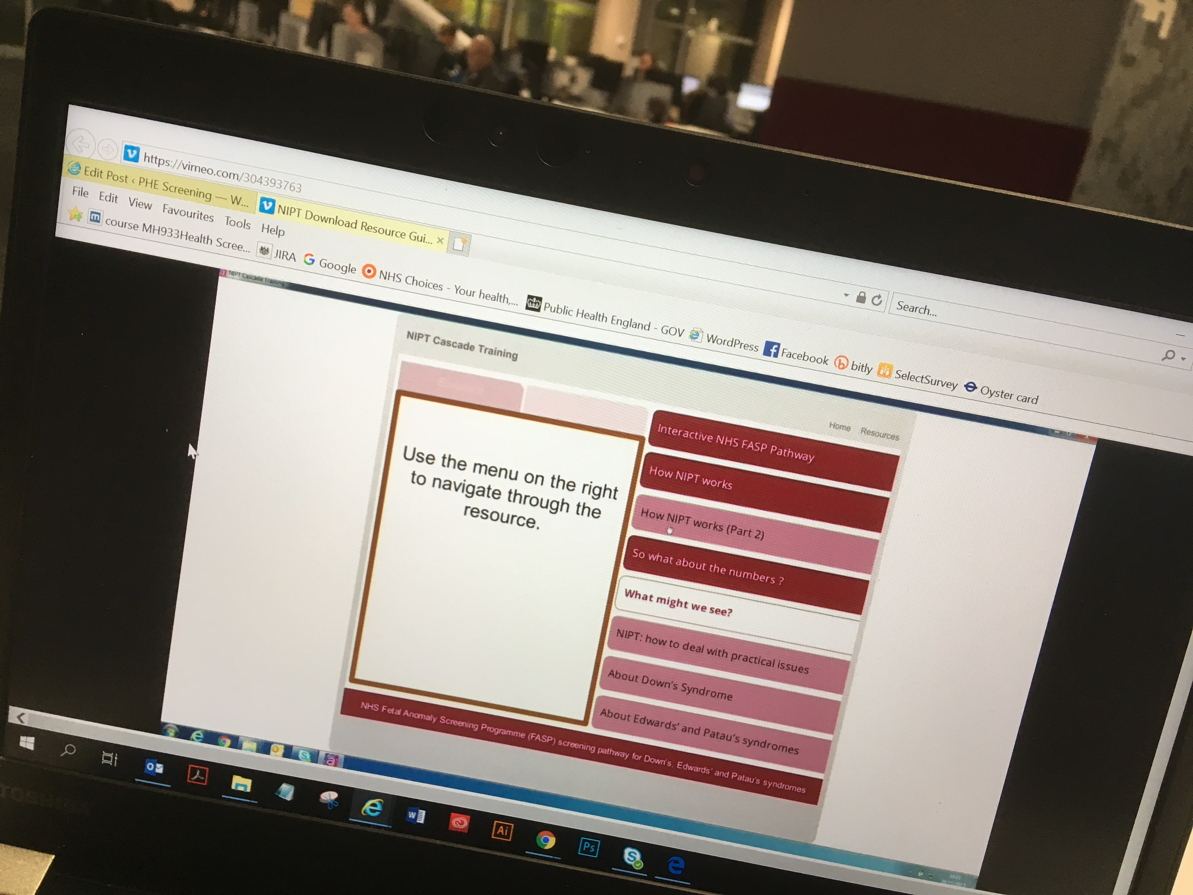 The photo shows the NIPT training resource displayed on a laptop.