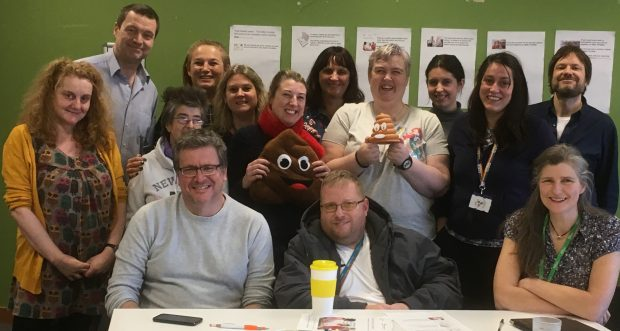 Picture of 14 people who took part in the review of bowel cancer screening easy read materials at the Newcastle workshop. Pictured in the photo are 4 experts by experience, 3 support workers, PHE Screening staff, health professionals and blog author Julie Tucker