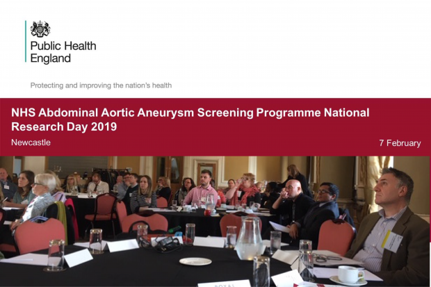 A presentation slide at the event with the title 'NHS Abdominal Aortic Aneurysm Screening Programme National Research Day 2019, Newcastle, 7 February' above a photograph of delegates sitting at tables listening to presentation at the national AAA screening research event held in Newcastle