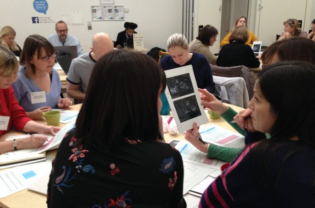 Photo of sonographers sitting in groups and talking during the national meeting