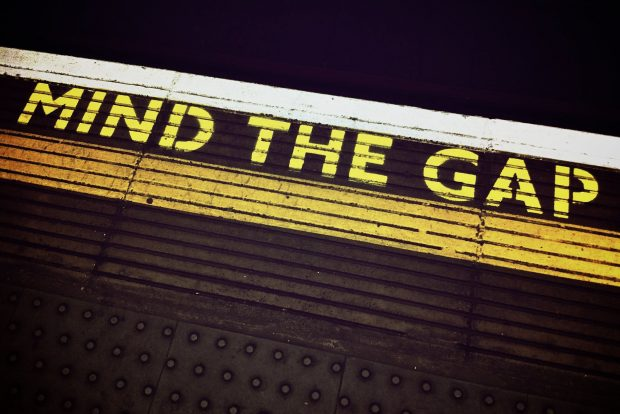 Image of 'MIND THE GAP' wording on London Underground station platform