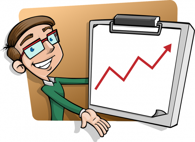 image shows a man with glasses holding a chart which shows overall progress.
