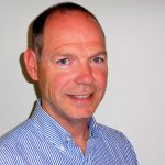 Head and shoulders photo of John.