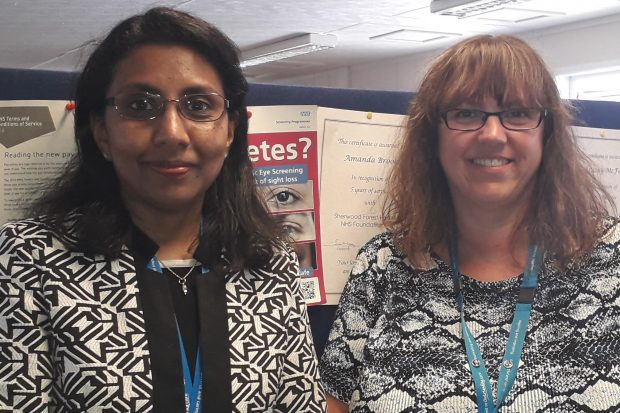 Head and shoulders photo of Amanda Brooks and Prema Maharajan stood in front of an office noticeboard.