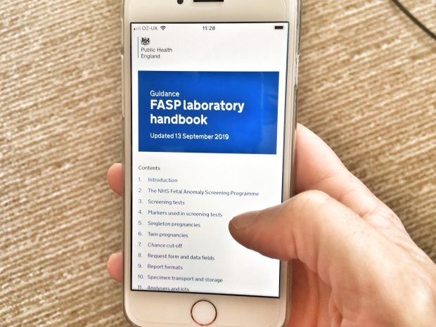 Mobile phone shows the new handbook online with the words 'FASP lab handbook' as the main heading.