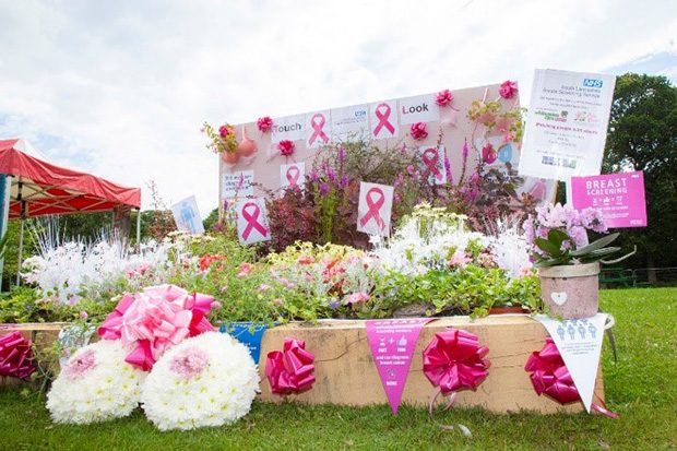 Raising awareness of breast screening through a very bright flower display and breast screening information and posters.