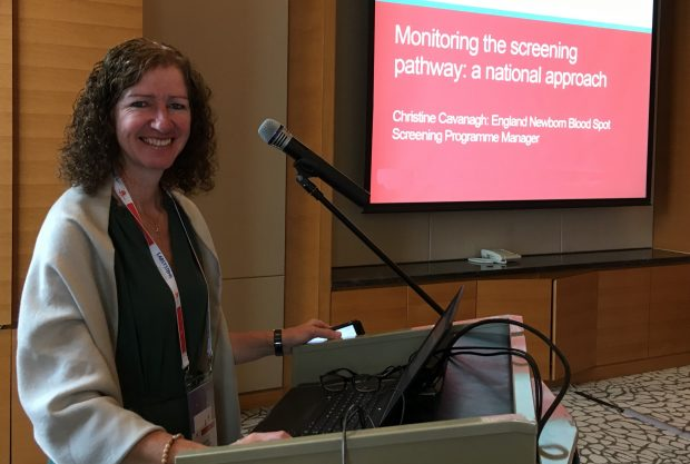 Christine Cavanagh stood at a lectern presenting at the 2019 ISNS conference in China.