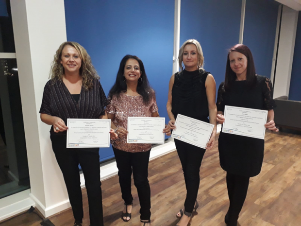 Michelle Johnson, Alpa Adatia, Izzy Petrie and Sarah Bailey are shown lined up holding certificates for completing the Level 3 Diploma in Newborn Hearing Screening.