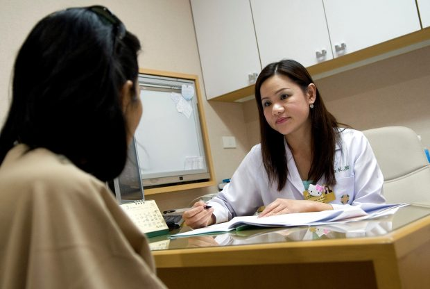 A female doctor talking to a patient